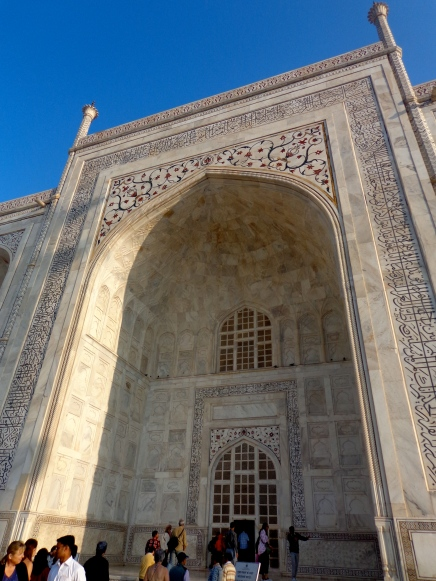 The Arabic inscriptions get larger as they go up the arch, so form the bottom, they all look like they're the same size.